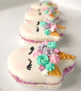 Vanilla-Raspberry Unicorn Macs, decorated with buttercream and royal icing.