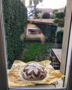 Sourdough cooking on the window sill on a rainy Parisian day