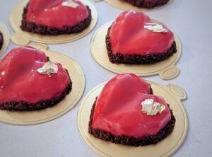 Individual chocolate-raspberry heart shaped entremets with raspberry mousse and chocolate ganache.PORTRAIT-01